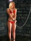 Paige turns up the heat in a red bikini and shiny metal restraints from SM Factory.